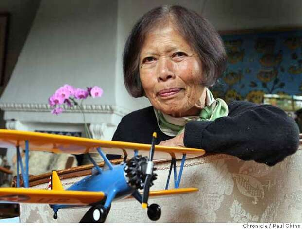 Maggie Gee with a scale model of a Stearman bi-plane at her home in Berkeley, Calif. on Saturday, Sept. 22, 2007. Gee was a civilian flight instructor for the Women's Airforce Service Pilots (WASP) and trained pilots on the Stearman during World War II.  PAUL CHINN/The Chronicle  **Maggie Gee Photo: PAUL CHINN