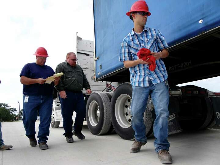 Eugene Martinez, left, Max Gasner, and Joseph Placencia go through a truck inspection exercise for d