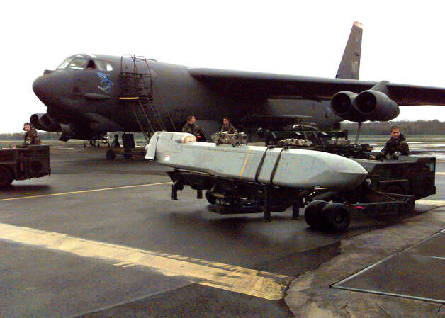 A cruise missile is carted to a waiting B-52 at RAF base Fairford, United Kingdom on March 30, 1999 in support Of NATO Operation  Allied Force in Kosovo. Photo: USAF, U.S. Air Force/Getty Images / Getty Images North America