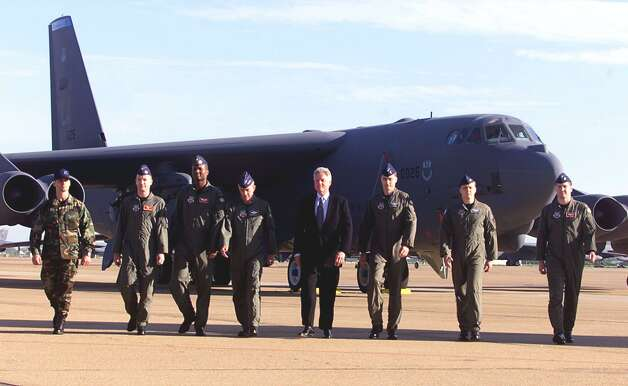 Then President Bill Clinton walks with members of the 2nd Bomb Wing in front of a B-52 bomber at Barksdale Air Force Base in Louisiana on April 12, 1999. Clinton was showing his support for the crisis in Kosovo. Photo: STEPHEN JAFFE, STEPHEN JAFFE/AFP/Getty Images / AFP