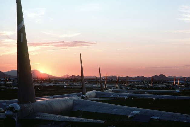 Dozens of inactive B-52s are bathed in the glow of the setting sun as they sit on the desert floor at the Aerospace Maintenance and Regeneration Group center at Davis-Monthan Air Base, in Tuscon, Ariz. Photo: USAF, U.S. Air Force / Getty Images North America
