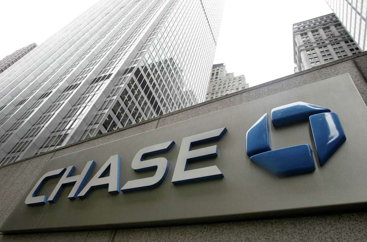 FILE - This Oct. 12, 2011 file photo shows a JPMorgan Chase bank building in New York. JPMorgan Chase, the nation's biggest bank, earned more in the first three months of the year than Wall Street analysts were expecting as mortgage lending increased. (AP Photo/Kathy Willens, File)