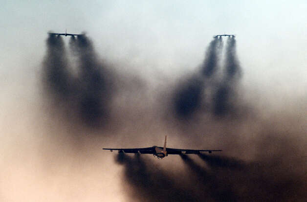 This undated photo shows three B-52s departing in formation during a minimum interval takeoff exercise, in which three cells of six B-52 and KC-10 Extender aircraft take off seconds apart under combat conditions. Photo: USAF, U.S. Air Force / Getty Images North America