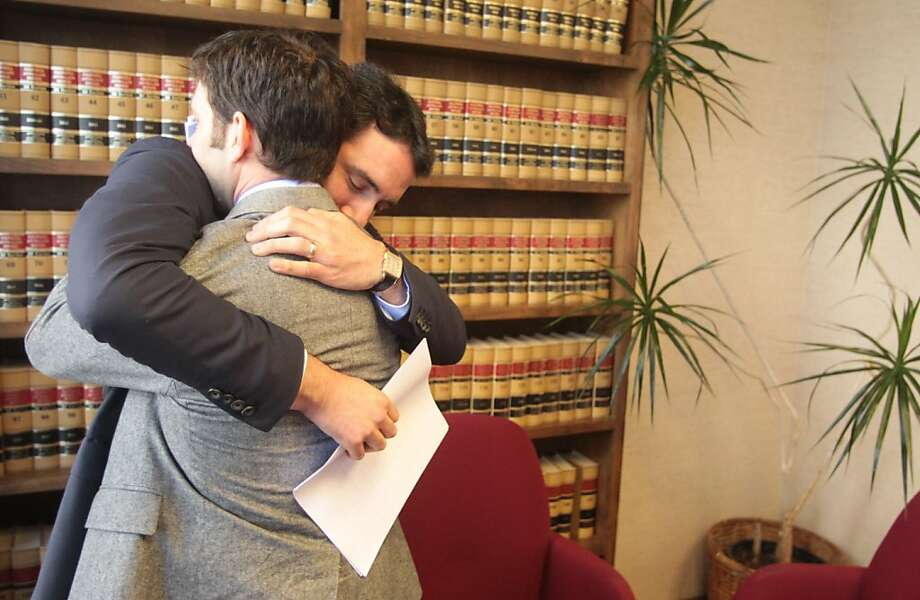 Christopher (right) and Alexander Cukor hug after a news conference where they said Berkeley police share blame for their father's death. Photo: Mathew Sumner, Special To The Chronicle
