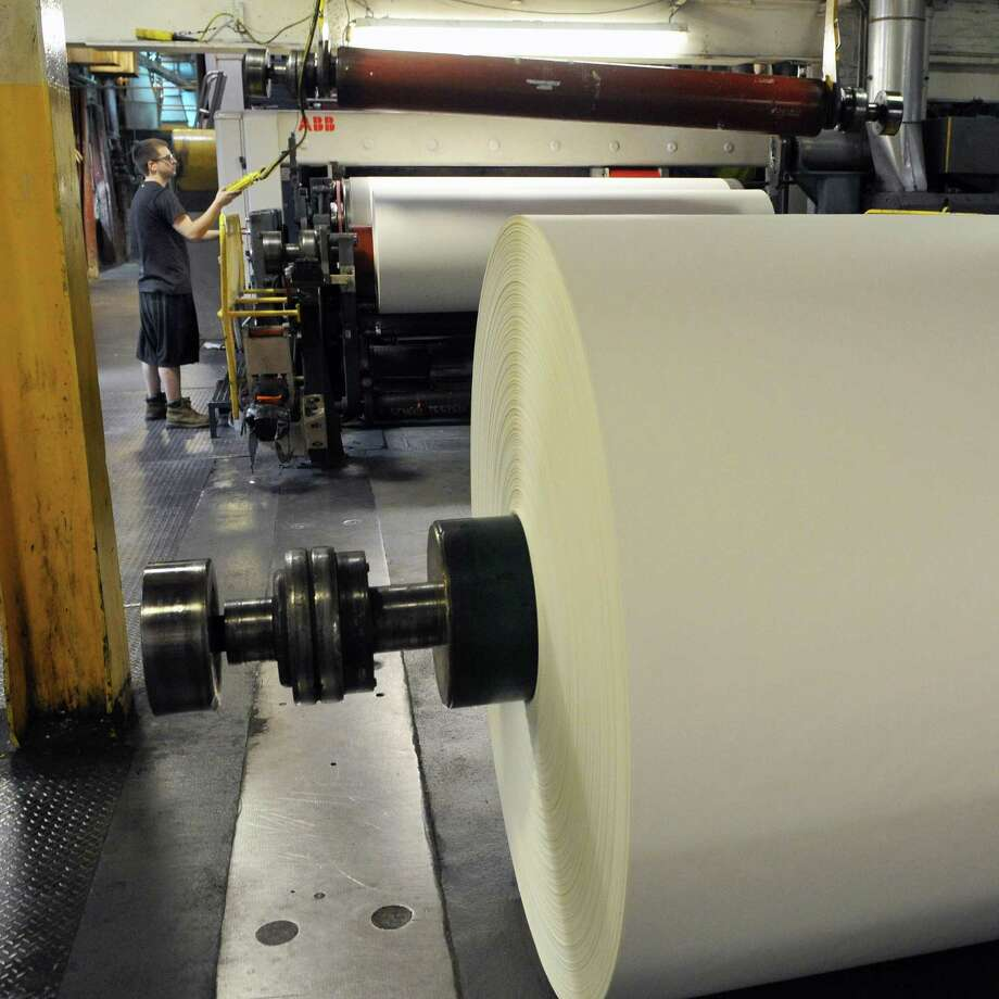 Six thousand pound reels of paper at Mohawk Fine Papers Cohoes plant Wednesday April 11, 2012.   (John Carl D'Annibale / Times Union) Photo: John Carl D'Annibale / 00017184A