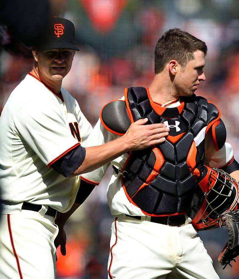 Starting pitcher Matt Cain of the San Francisco Giants greets his catcher Buster Posey after the Giants defeated the Pittsburgh Pirates at AT&T Park during their home opener Friday April 13, 2012 in San Francisco, Calif. The Giants won 5-0. Photo: Lance Iversen, The Chronicle