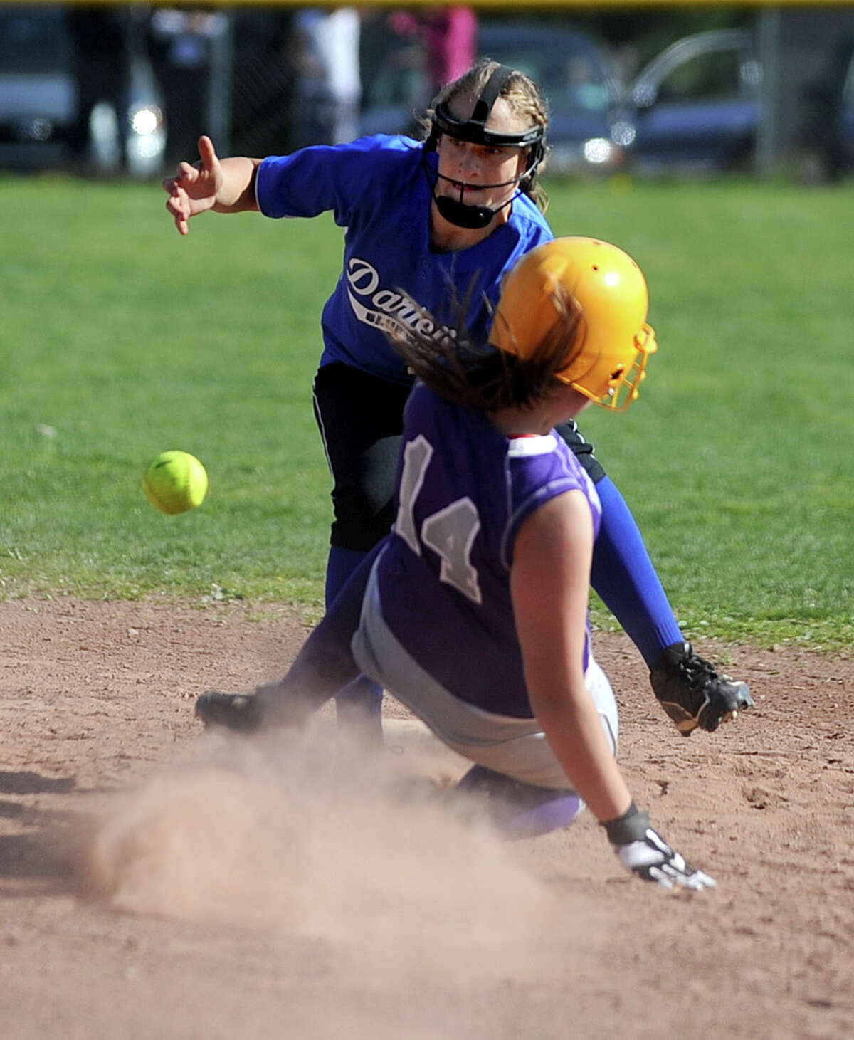 Darien's Erika Osherow reaches for the ball as Westhill's Cassandra Kish slides into second base during Friday's softball game at Westhill High School in Stamford on April 13, 2012.