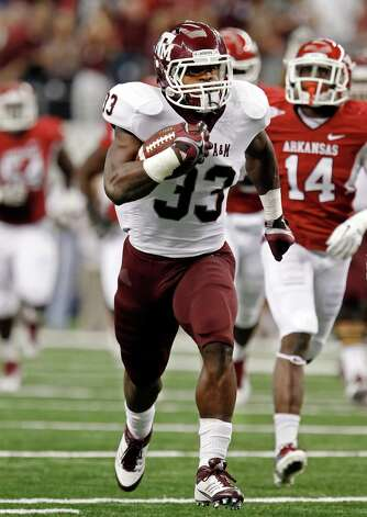 Texas A&M running back Christine Michael (33) gets past the Arkansas defense to score a touchdown during the first quarter of an NCAA college football game at Cowboys Stadium on Saturday, Oct. 1, 2011, in Arlington, Texas. Photo: AP
