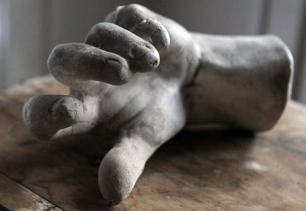 A sculpture of a hand creates an area of interest in the front living area in the Monticello home of Freddie Delgado. (Wednesday April 11, 2012) John Davenport/San Antonio Express-News Photo: John Davenport