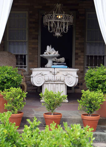An outdoor porch has an interesting chandelier and a table made from a building's column at the Monticello home of Freddie Delgado. (Wednesday April 11, 2012) John Davenport/San Antonio Express-News Photo: John Davenport
