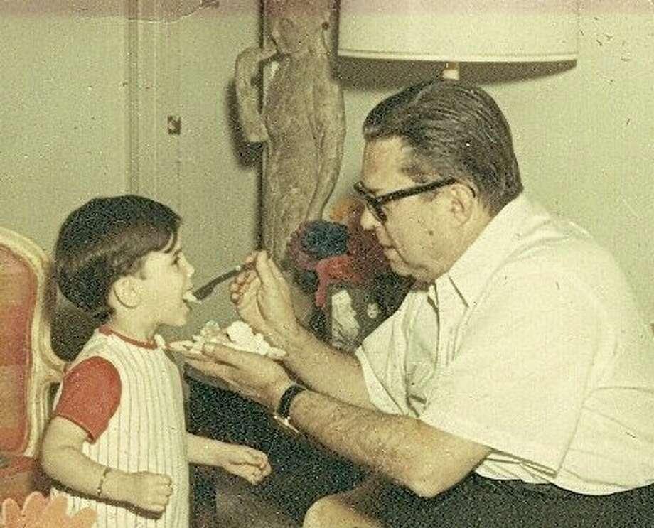 Judge Roy Hofheinz shares a bit of birthday cake with his grandson, Dinn Mann.