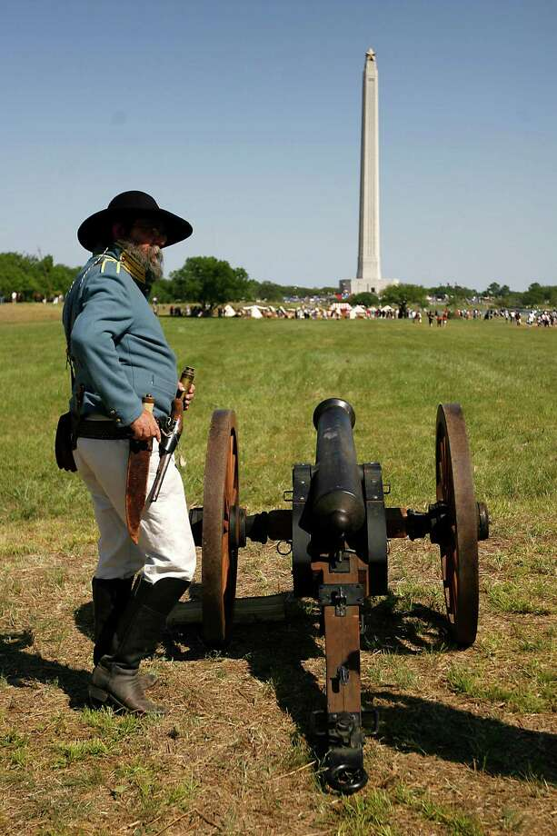 Col. Don Herlitz, playing the part of a US Military advisor to the Texian Army, stands next to a cannon on the grounds of the San Jacinto Battleground, near the San Jacinto Monument,Saturday, April 16, 2011, in Houston, as hundreds of history re-enactors recreate the events leading up to and including the Battle of San Jacinto.  This year marks the 175th anniversary of Texas' Independence.  ( Karen Warren / Houston Chronicle ) Photo: Karen Warren / Houston Chronicle