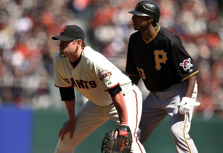 San Francisco Giants Aubrey Huff holds Pittsburgh Pirates James McDonald on first base after McDonald got a base hit in the sixth inning against Giants starter Matt Cain Friday, April 13, 2012, in San Francisco Calif. Giants won 5-0 Photo: Lance Iversen, The Chronicle
