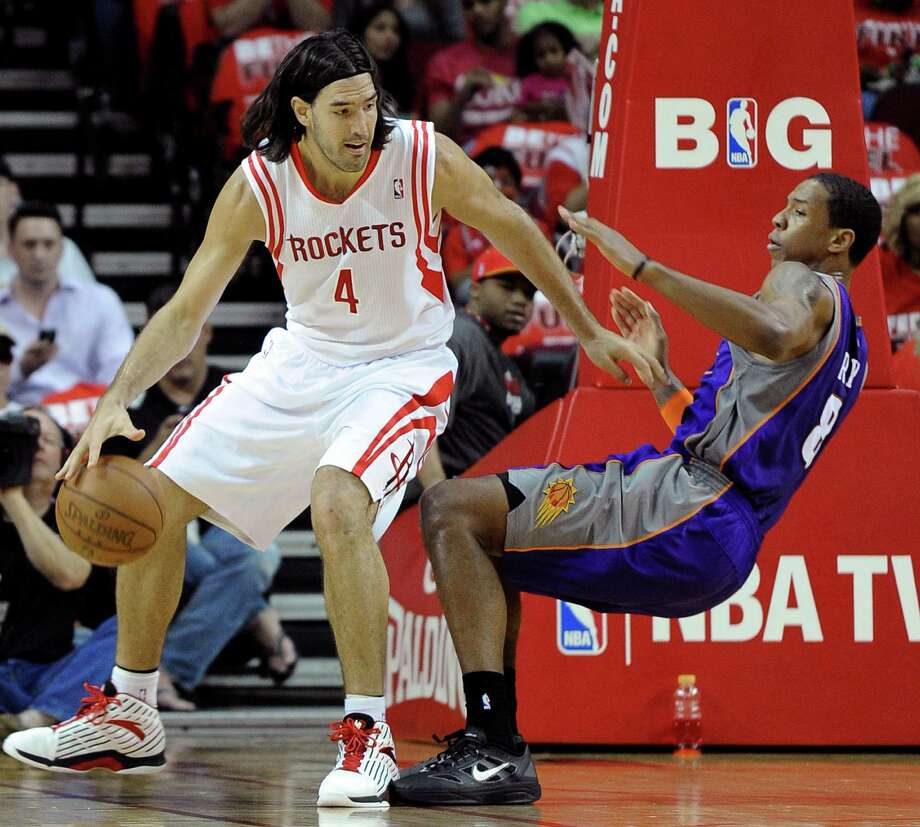 Houston Rockets' Luis Scola (4) runs into Phoenix Suns' Channing Frye (8) in the first half of an NBA basketball game on Friday, April 13, 2012, in Houston. Frye was charged with a foul on the play. (AP Photo/Pat Sullivan) Photo: Pat Sullivan, Associated Press / AP