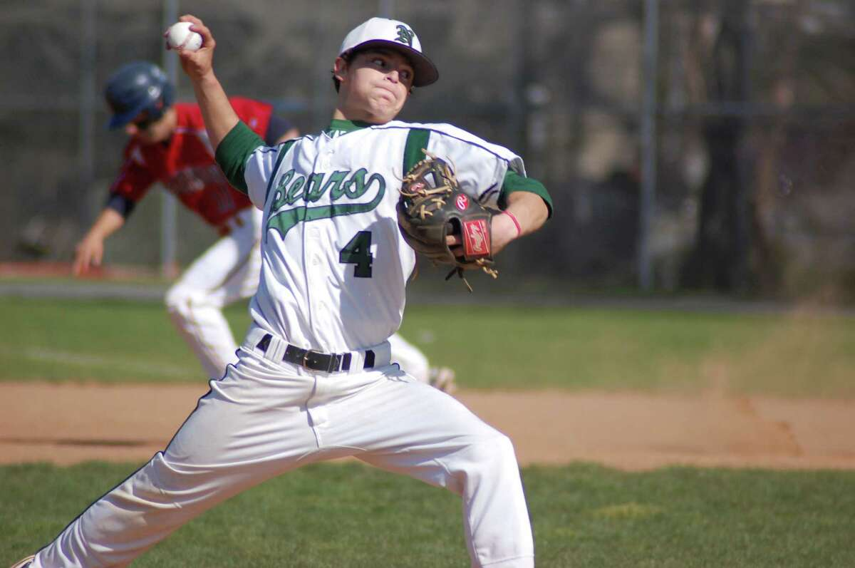 Norwalk right-hander Lucas LaBry pitches as Brien McMahon's Bryan Daniello heads toward second base in the background in the Senators' 12-3 win on Friday at City Hall Field.