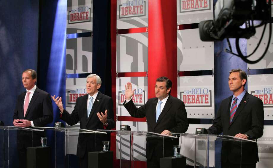 Republican candidates for U.S. Senate, Tom Leppert and Ted Cruz (center left and right) jockey for an opportunity to answer a question early as Lt. Governor David Dewhurst, left, and  Craig James, listen during the Belo Debate Friday night, April 13, 2012 at the WFAA studios in Dallas, Texas. The four are vying  for the seat of retiring Sen. Kay Bailey Hutchison. Photo: AP