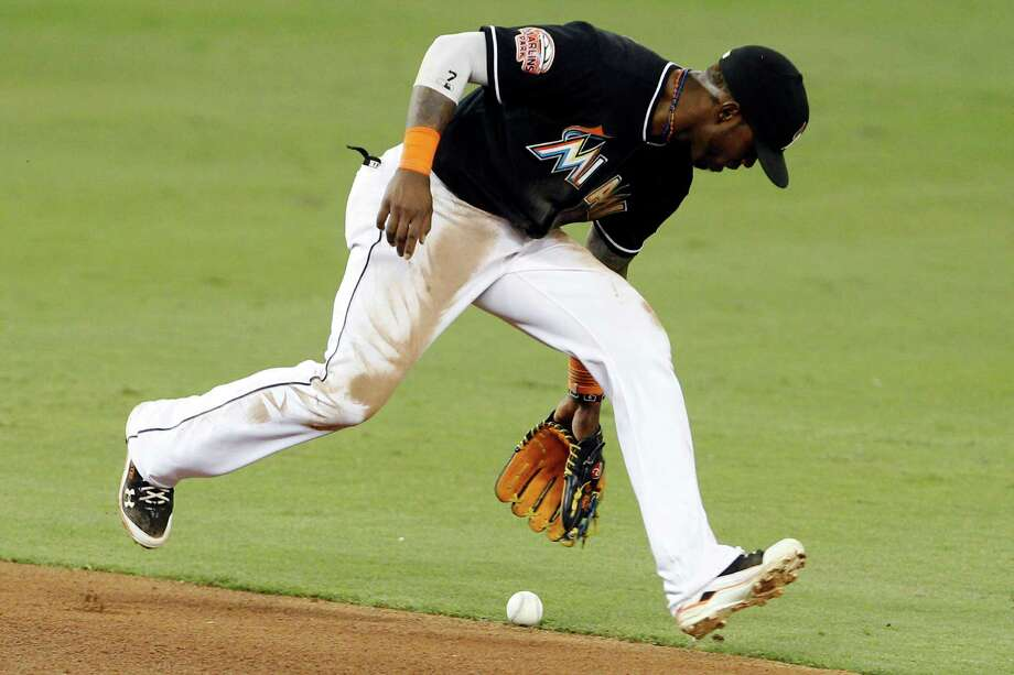 Miami Marlins shortstop Jose Reyes loses control of the ball for an error on a ball hit by Houston Astros' Jose Altuve in the seventh inning during a baseball game, Friday, April 13, 2012, in Miami. (AP Photo/Lynne Sladky) Photo: Lynne Sladky, Associated Press / AP