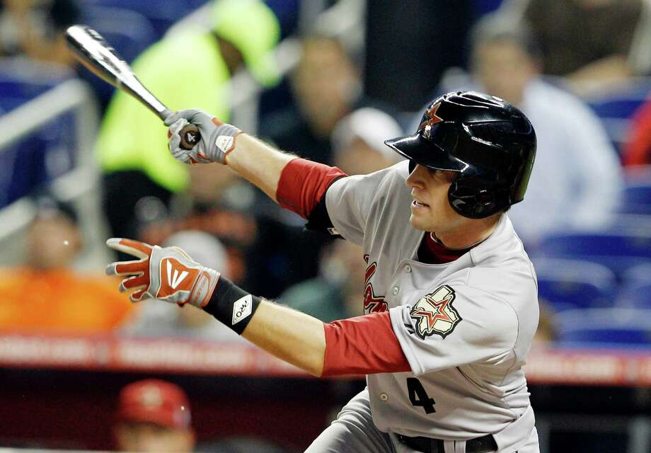 Houston Astros' Jed Lowrie (4) follows through on a RBI-single to score Jordan Schafer in the first inning during a baseball game against the Miami Marlins, Friday, April 13, 2012, in Miami. (AP Photo/Lynne Sladky) Photo: Lynne Sladky, Associated Press / AP