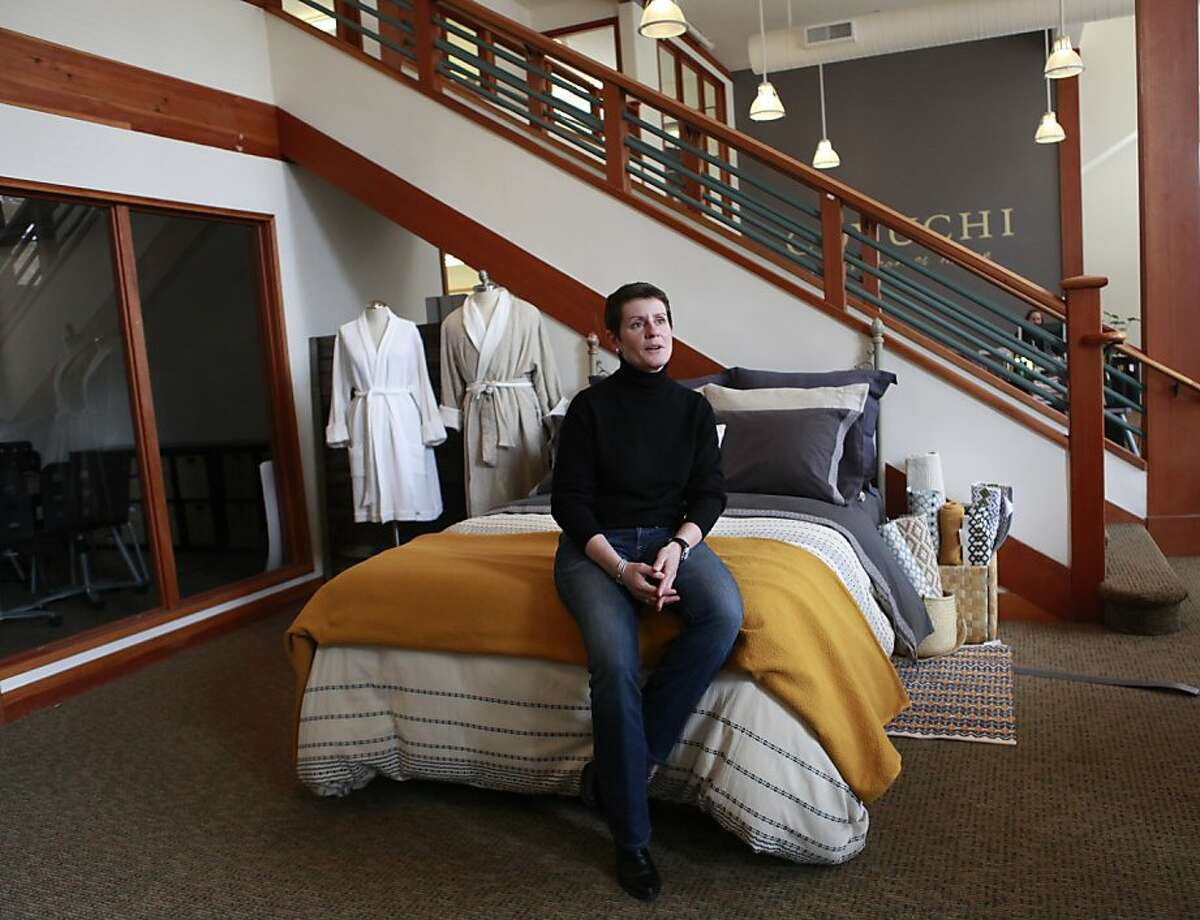 Karyn Barsa, CEO of Berkeley's Coyuchi, sits on their 'test bed' in their office displaying linens, in Berkeley, California on Wednesday, April 11, 2012.