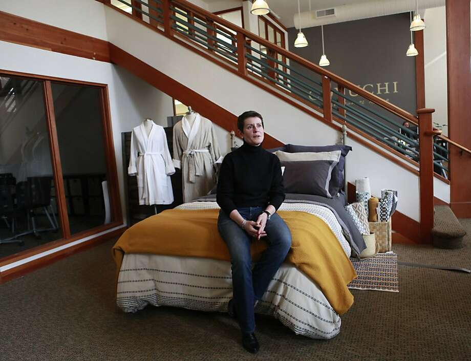 Karyn Barsa, CEO of Berkeley's Coyuchi, sits on their 'test bed' in their office displaying linens, in Berkeley, California on Wednesday, April 11, 2012. Photo: Jill Schneider, The Chronicle