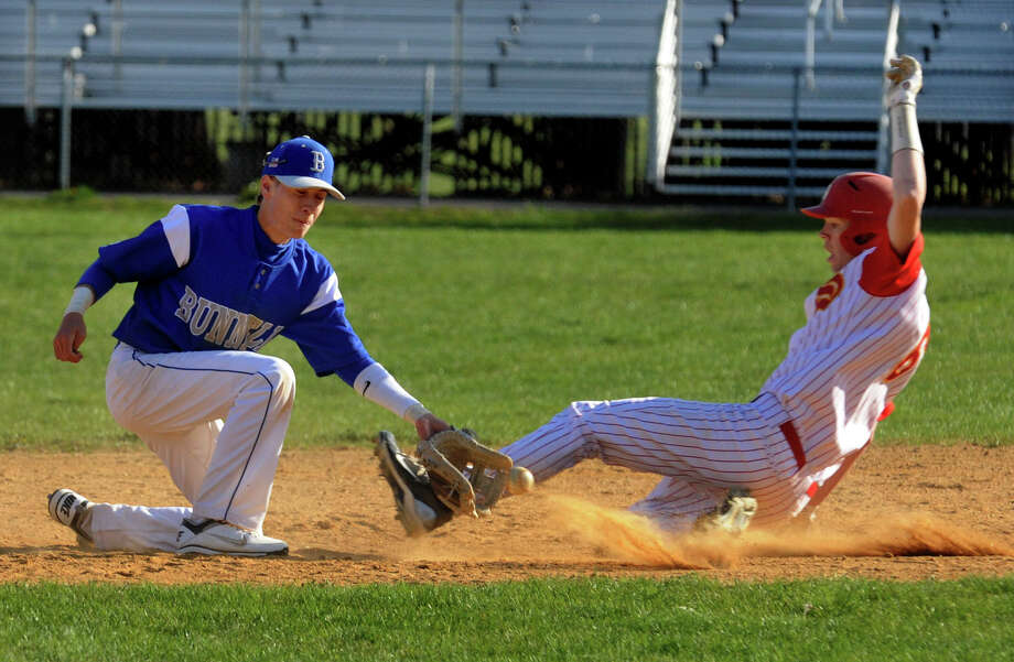 during boys baseball action in Stratford, Conn. on Friday April 13, 2012. Photo: Christian Abraham / Connecticut Post