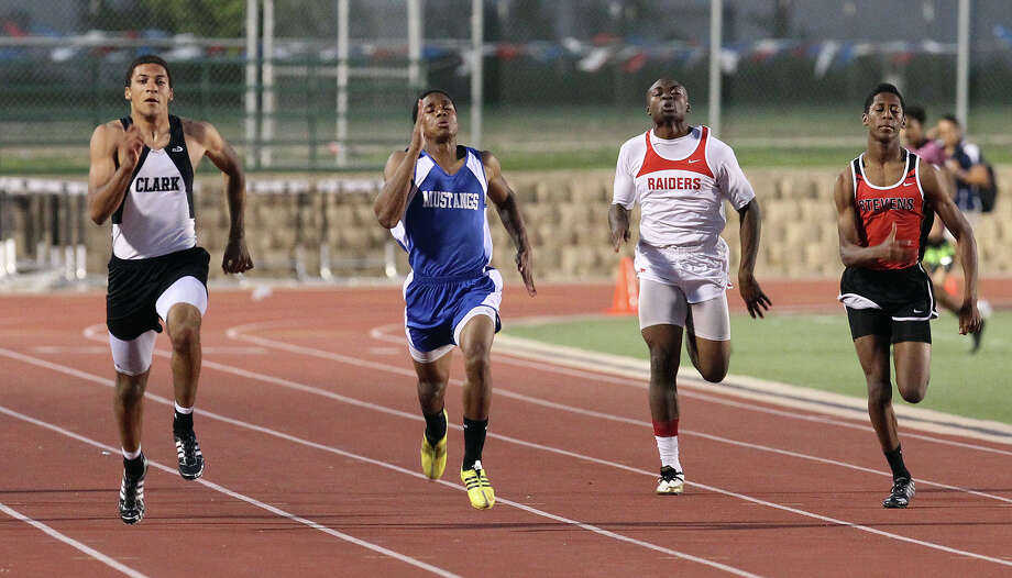 Clark's Brandon Yates (second from left) sprints to first place against Jay's Bryce Balous (second from right) in the 200-meter dash at the District 27-5A track meet at Gustafson Stadium on Friday, Apr. 13, 2012. Kin Man Hui/Express-News. Photo: Kin Man Hui, Kin Man Hui/Express-News / ©2012 San Antonio Express-News