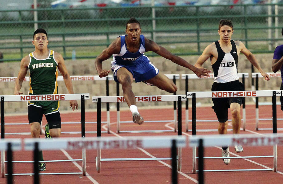 Jay's Joshua Reynolds (center) leads the group to take first in the 300-meter hurdles at the District 27-5A track meet at Gustafson Stadium on Friday, Apr. 13, 2012. Kin Man Hui/Express-News. Photo: Kin Man Hui, Kin Man Hui/Express-News / ©2012 San Antonio Express-News