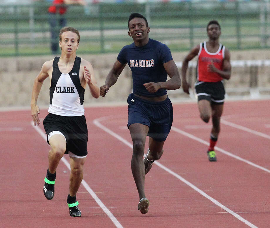 Clark's Ben Deschner (left) edges out Brandeis Raymond Flowers in the 400-meter dash at the District 27-5A track meet at Gustafson Stadium on Friday, Apr. 13, 2012. Kin Man Hui/Express-News. Photo: Kin Man Hui, Kin Man Hui/Express-News / ©2012 San Antonio Express-News