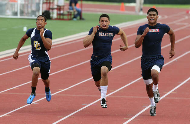 Brandeis' Colin Blake (right) takes first in the 100-meter dash against teammate Nick Sierra (center) and O'Connor's Jeilyn Wiliams (left) at the District 27-5A track meet at Gustafson Stadium on Friday, Apr. 13, 2012. Kin Man Hui/Express-News. Photo: Kin Man Hui, Kin Man Hui/Express-News / ©2012 San Antonio Express-News