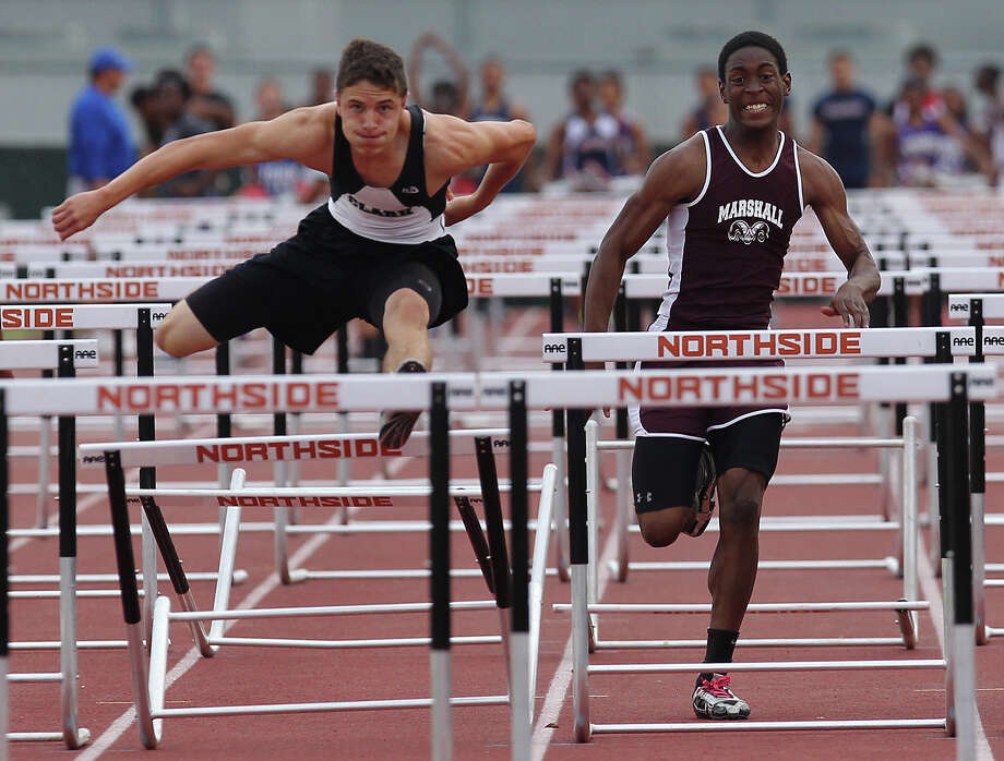 Clark's Presley Miller (left) edges out Marshall's Parabron Hawkins to take first in the 110-meter hurdles at the District 27-5A track meet at Gustafson Stadium on Friday, Apr. 13, 2012. Kin Man Hui/Express-News. Photo: Kin Man Hui, Kin Man Hui/Express-News / ©2012 San Antonio Express-News