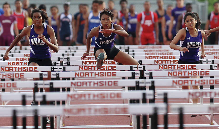 Warren's Jerica Love (center) leads her teammates Amaris Castro (right) and Jade Paris (left) to finish first in the 100-meter hurdles at the District 27-5A track meet at Gustafson Stadium on Friday, Apr. 13, 2012. Kin Man Hui/Express-News. Photo: Kin Man Hui, Kin Man Hui/Express-News / ©2012 San Antonio Express-News