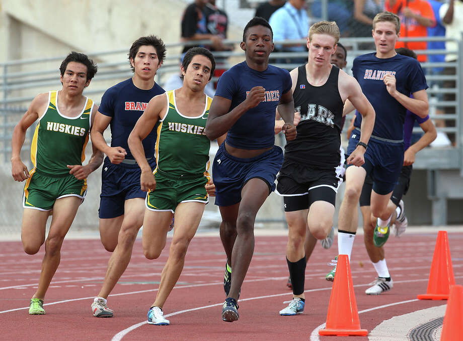 Brandeis' Raymond Flowers (center) runs ahead of the pack in the second lap of the 800-meter run. Flowers kept the lead to finish first in the event at the District 27-5A track meet at Gustafson Stadium on Friday, Apr. 13, 2012. Kin Man Hui/Express-News. Photo: Kin Man Hui, Kin Man Hui/Express-News / ©2012 San Antonio Express-News