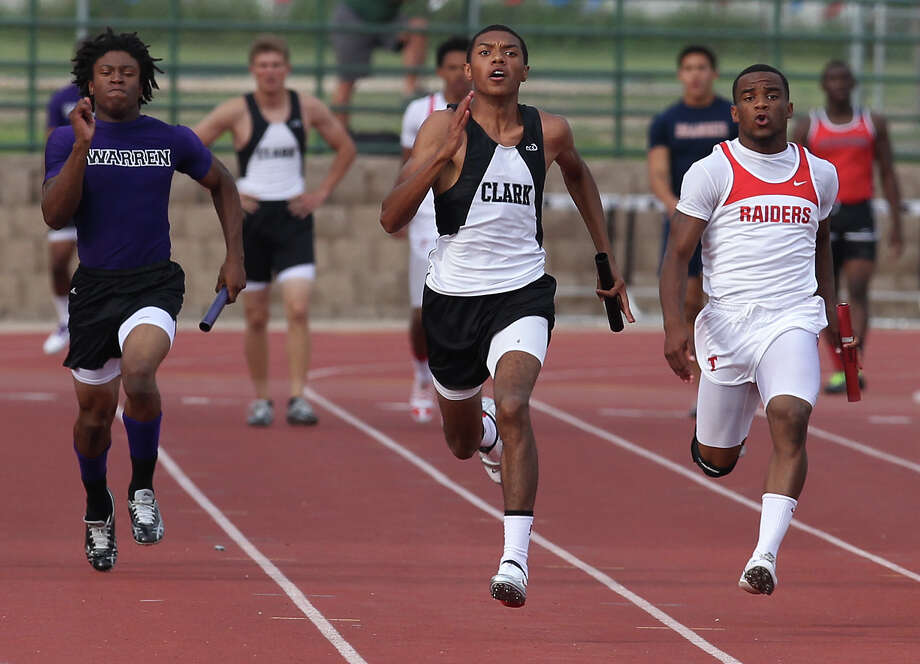 Clark's Giovanni Maxwell (center) edges out Taft's Jordan Battles (right) to help his team finish first in the 400-meter relay at the District 27-5A track meet at Gustafson Stadium on Friday, Apr. 13, 2012. Kin Man Hui/Express-News. Photo: Kin Man Hui, Kin Man Hui/Express-News / ©2012 San Antonio Express-News