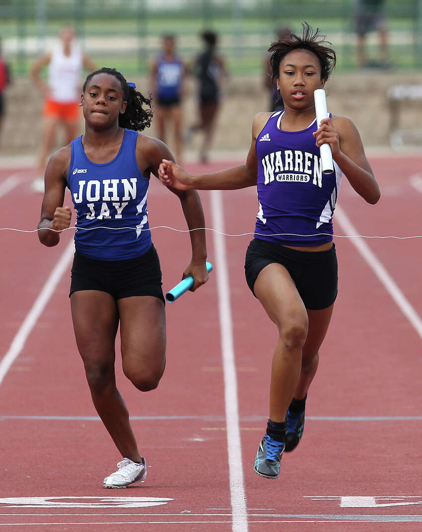 Warren's Jerica Love (right) crosses first to the finish line as the anchor runner in the 400-meter relays at the District 27-5A track meet at Gustafson Stadium on Friday, Apr. 13, 2012. Kin Man Hui/Express-News.