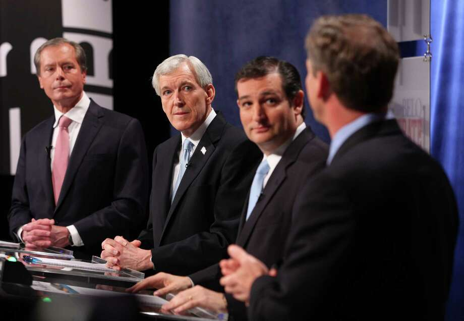 GOP hopefuls for U.S. Senate, from left, Lt. Governor David Dewhurst, Tom Leppert and Ted Cruz listen to a response from Craig James. Photo: Brad Loper / The Dallas Morning News