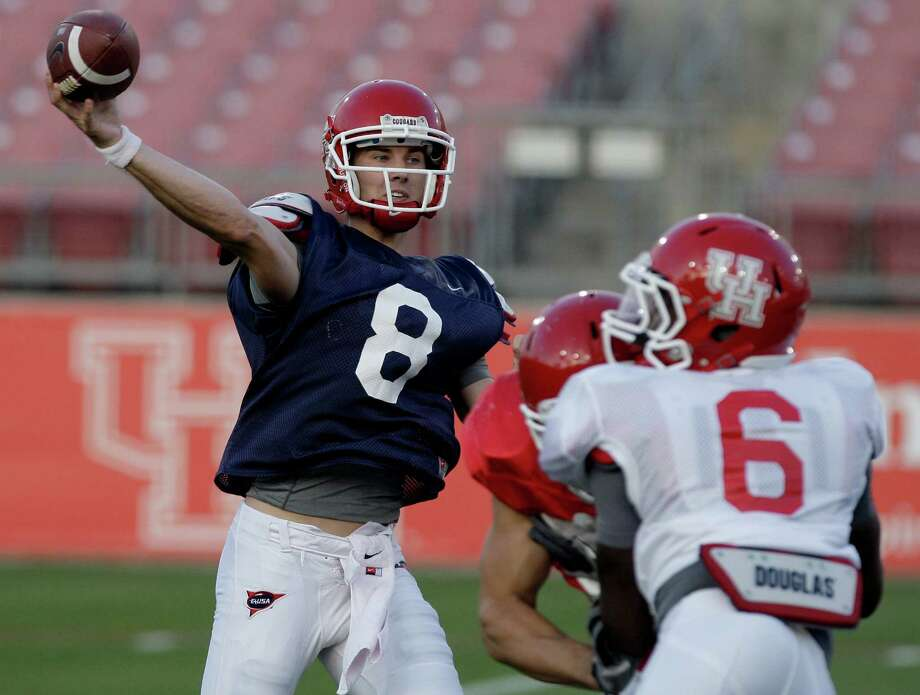 Quaterback David Piland (8) of the red team completes a pass against the white team in the UH spring football game at Robertson Stadium in Houston, Texas.  The red team won 42 to 28. Photo: Thomas B. Shea, For The Chronicle / © 2012 Thomas B. Shea