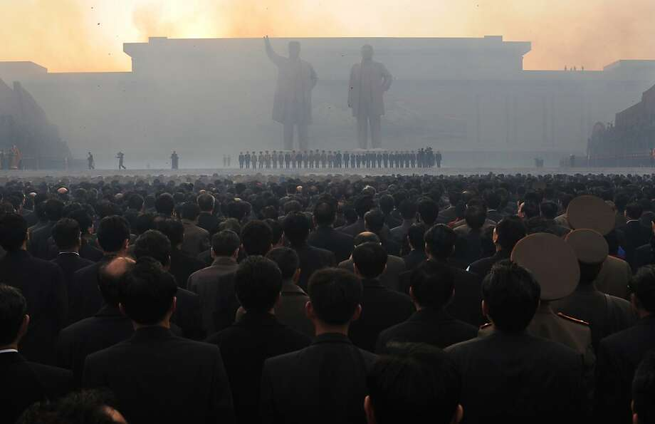North Koreans watch fireworks during an unveiling ceremony of two statues of former leaders Kim Jong-Il (R) and Kim Il-Sung (L) in Pyongyang on April 13, 2012. North Korea's new leader Kim Jong-Un on April 13 led a mass rally for his late father and grandfather following the country's failed rocket launch. Photo: Pedro Ugarte, AFP/Getty Images