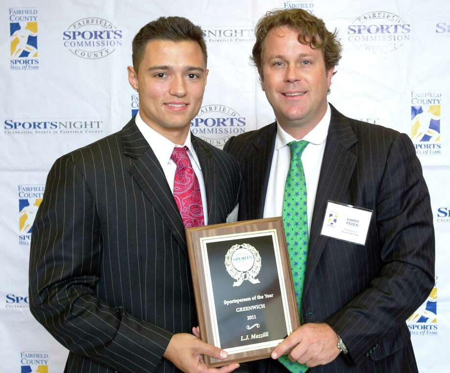 UConn baseball standout L.J. Mazzilli, left, is presented with the Greenwich Sports Person of the Year plaque from Fairfield County Sports Commission Board of Directors President Harry Peden, a Greenwich resident, at the 7th annual SportsNight dinner last week at the Hyatt Regency Greenwich. Photo: Contributed Photo