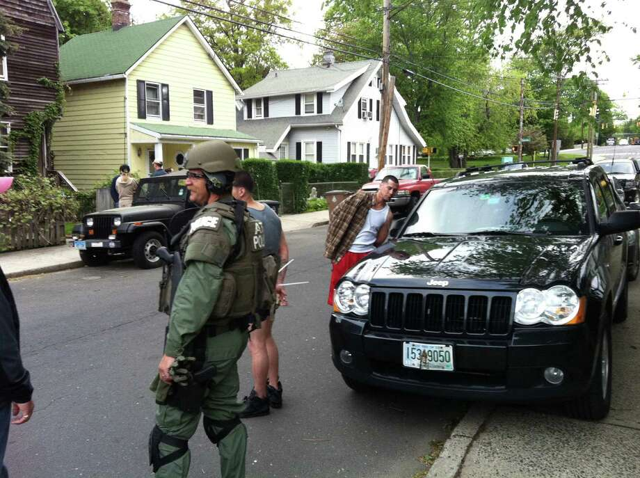 Federal agents raided a house early Thursday morning, May 12, 2011 in Stamford, Conn. and took at least two men into custody. Photo: John Nickerson, ST / Stamford Advocate