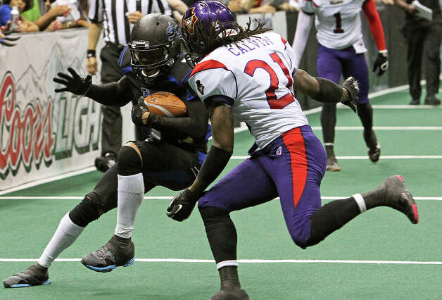 Talons receiver Jason Willis rolls away fromJorrick Calvin after gaining yards on a catch as the San antonio Talons host the New Orleans Voodoo at the Alamodome on  April 13, 2012.  Tom Reel/ San Antoniopress-News Photo: TOM REEL, Express-News / San Antonio Express-News
