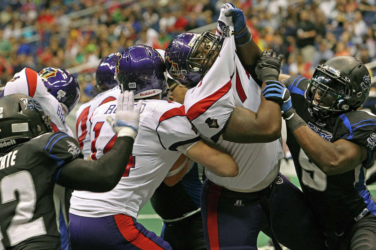 Talons lineman Daverin Geralds (center right) can't stop the defensive pressure by Jerry Brown (9) and Victor De Gatte (42) forcing quarterback Kurt Rocco to run and then fumble the ball away as the San antonio Talons host the New Orleans Voodoo at the Alamodome on April 13, 2012. Tom Reel/ San Antoniopress-News