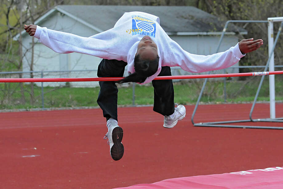 Emma Willard track star Keishorea Armstrong practices the high jump at practice April 10, 2012 in Troy, N.Y. (Lori Van Buren / Times Union) Photo: Lori Van Buren