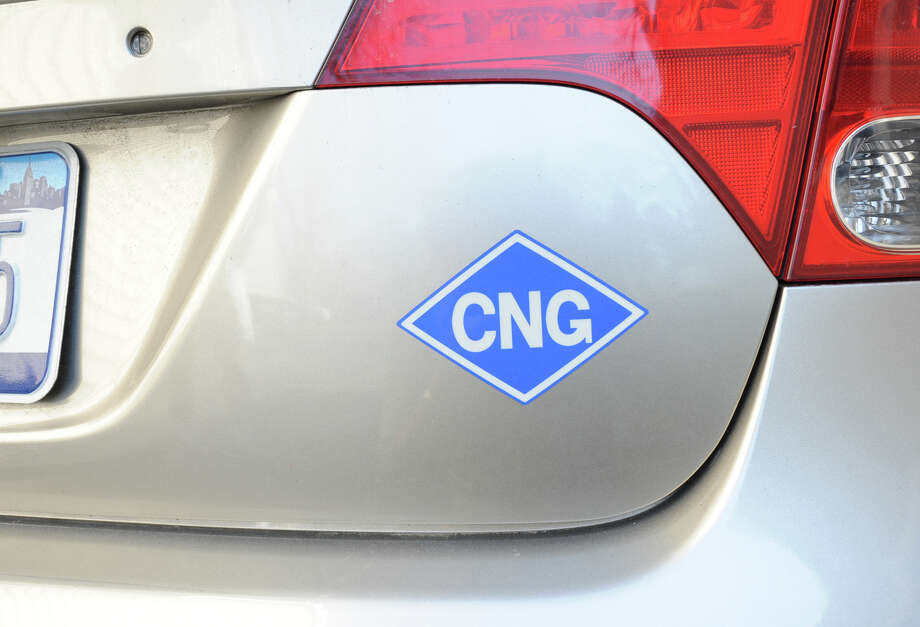 A sticker on a Honda Civic shows that it uses compressed natural gas. The price slump in natural gas has renewed interest in such vehicles. Photo: Lori Van Buren / ONLINE_YES