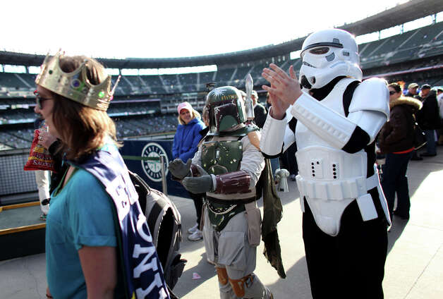 "Aaron Kirby, dressed as a ""Star Wars"" Storm Trooper, and Alex Saul, dressed as Boba Fett, march around the stadium cheering for the Mariners. Photo: JOSHUA TRUJILLO / SEATTLEPI.COM"