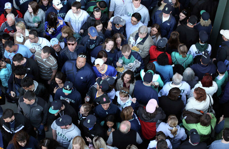Fans try to negotiate the Safeco Field crowds during the Seattle Mariners home opener.