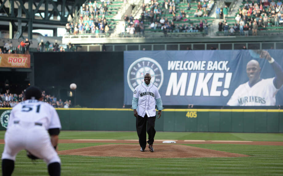 Mike Cameron throws out the ceremonial first pitch to former teammate Ichiro Suzuki. Photo: JOSHUA TRUJILLO / SEATTLEPI.COM