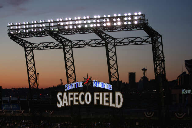 The Safeco Field sign is illuminated against the sunset. Photo: JOSHUA TRUJILLO / SEATTLEPI.COM