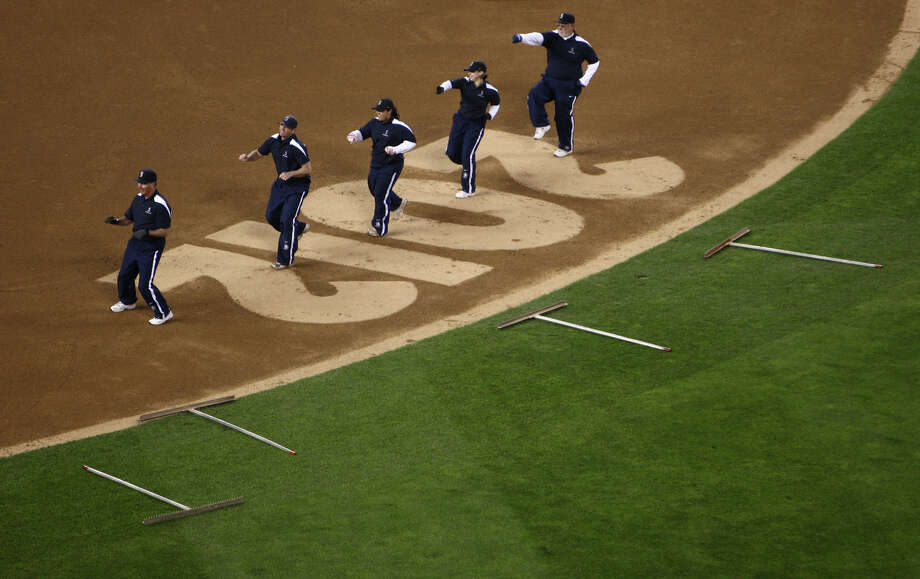 The Safeco Field grounds crew does a dance between innings. Photo: JOSHUA TRUJILLO / SEATTLEPI.COM