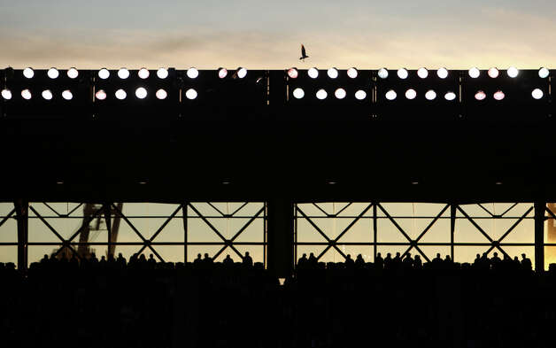 The sun sets behind Safeco Field. Photo: JOSHUA TRUJILLO / SEATTLEPI.COM