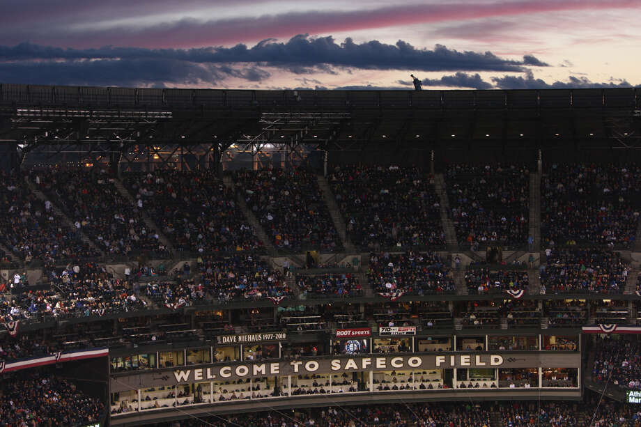 The sun sets behind Safeco Field during the Seattle Mariners home opener. Photo: JOSHUA TRUJILLO / SEATTLEPI.COM